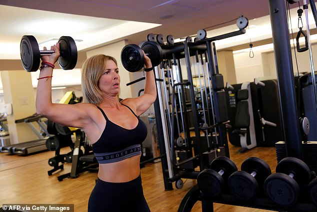"""A holder of the """"green pass"""" (proof of being fully vaccinated against the coronavirus), trains at a gym in the Israeli coastal city of Tel Aviv, on February 21"""