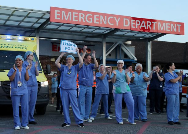Doctors, nurses and NHS staff outside the William Harvey Hospital, in Ashford, Kent, to salute local heroes (file photo)