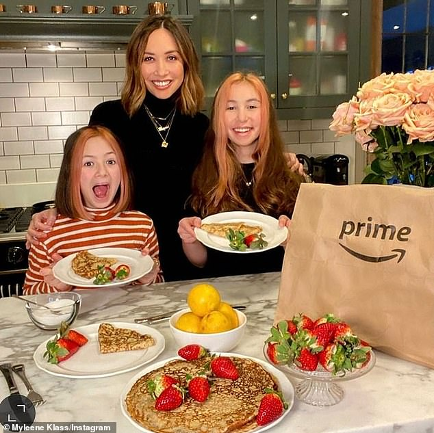 Our turn:Elsewhere Myleene Klass rolled up her shirtsleeves and whipped up a handful of impressive pancakes with the help of daughters Ava, 13, and Hero, nine