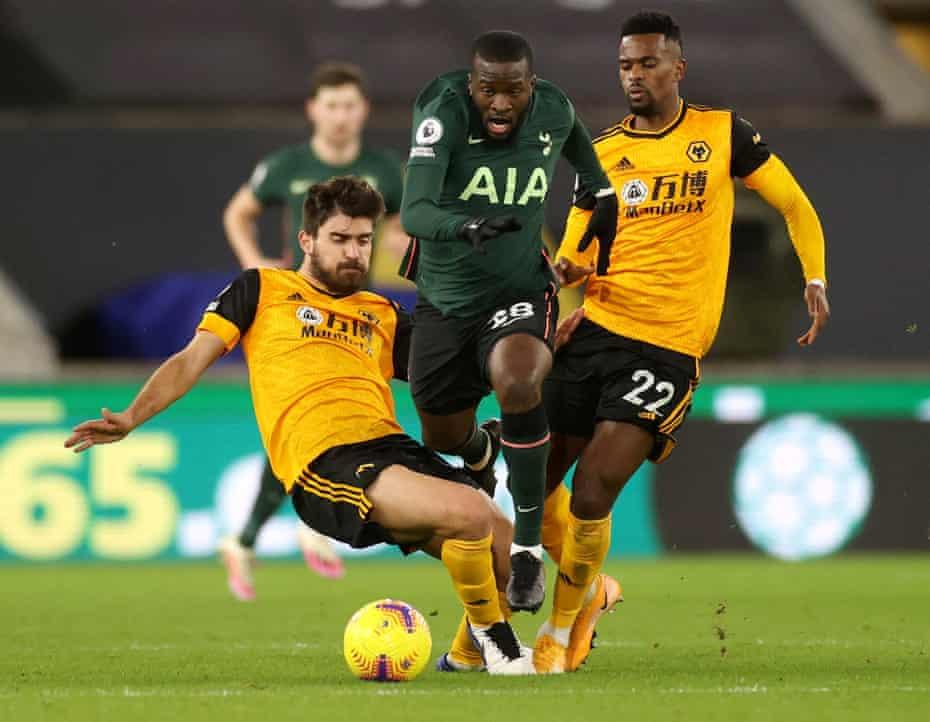 Tottenham Hotspur's Tanguy Ndombele in action with Wolverhampton Wanderers' Ruben Neves and Nelson Semedo.