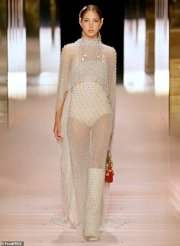 Model material:The rising star, 18, who modelled alongside her mum in the Fendi runway show last month (pictured), showcased her midriff in a knitted crop top and pyjamas