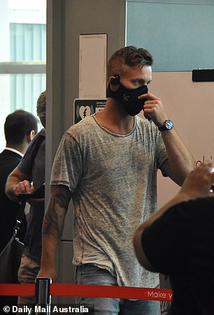 Safety first: Pictured: Groom JakeEdwards arriving in Sydney earlier this week