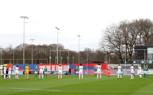 Players and officials take part in a minute of applause in memory of Captain Sir Tom Moore.