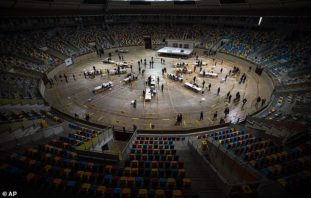 People line up and cast their votes at a polling station set up at the Tarraco Arena Plaza, the renamed Tarragona Bullring
