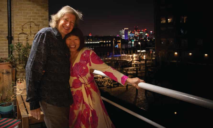Guy Hibbert and Meifu Wang Hibbert celebrating on a balcony
