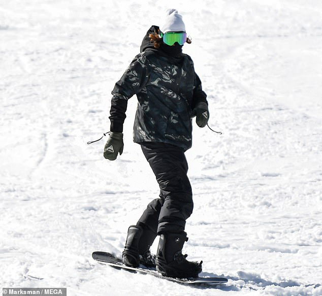 Cool rider: Brody made snowboarding look effortless as he made his way through the powder in a camouflage-printed puffy jacket