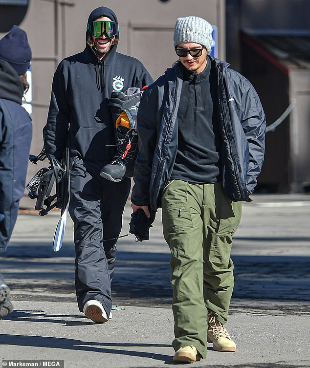 Boys club: Brody and Brandon shared a laugh as they made their way out of the resort lodge. 37-year-old Jenner looked relaxed in his black hoodie and matching black snow pants