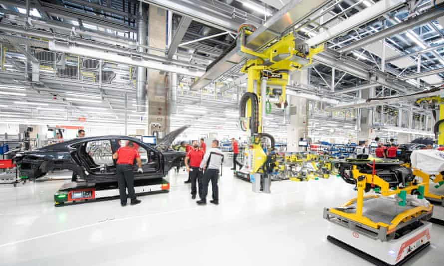 Baden-Württemberg's state capital Stuttgart is a manufacturing hub and home to Mercedes-Benz and Porsche, where employees produce the all-electric Taycan model.