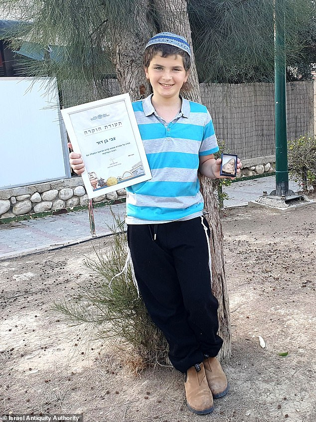 Zvi Ben-David, 11, was issued a certificate of appreciation for discovering the ceramic fertility amulet, one of only two ever discovered