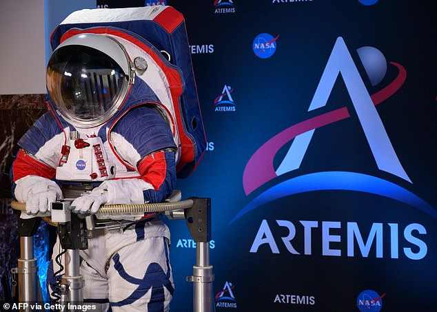 A space suit is seen during a press conference displaying the next generation of space suits as parts of the Artemis program