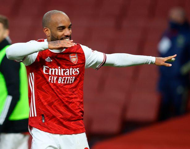 Alexander Lacazette celebrates his penalty