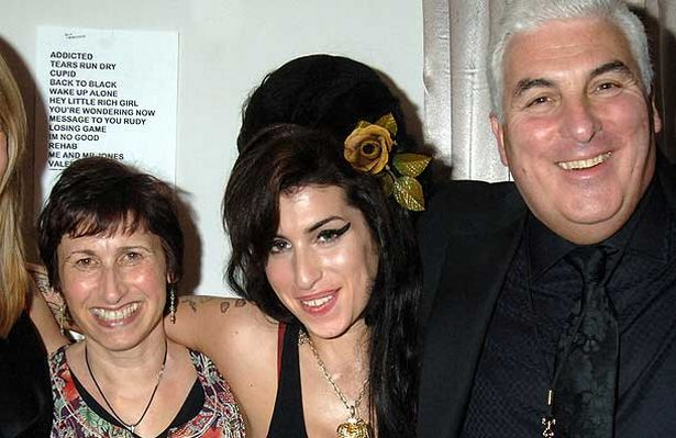 Amy Winehouse with her parents after winning five Grammy Awards in February 2008