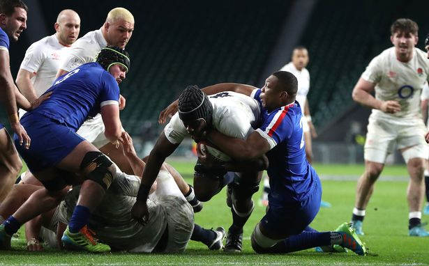 What a difference a fortnight makes: Itoje scores England's winning try against France (above) and (below) dejected England players at final whistle in Wales