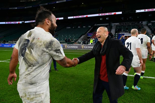 ...and is congratulated by Eddie Jones at final whistle