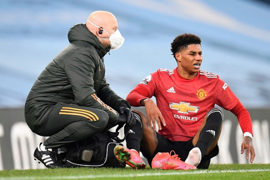 Manchester United's English striker Marcus Rashford reacts after leaving the pitch injured during the English Premier League football match between Manchester City and Manchester United at the Etihad Stadium in Manchester, north west England, on March 7, 2021.
