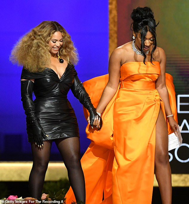 Epic: Megan also admitted it was an 'epic moment' for her to go on stage holding hands with Beyonce as they accepted the Best Rap Performance honor
