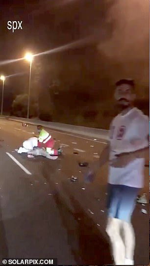 First responders try to save Juan David after the crash
