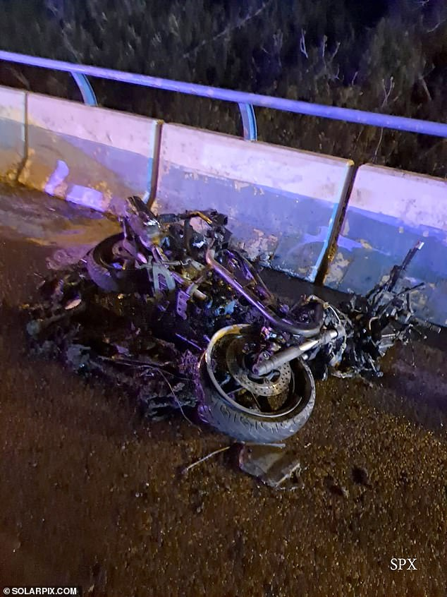 The accident happened around 8.30pm on Saturday on the A-7 dual-carriageway near the turn-off for the upmarket holiday resort of Puerto Banus. Pictured: The burnt motorbike of Juan David