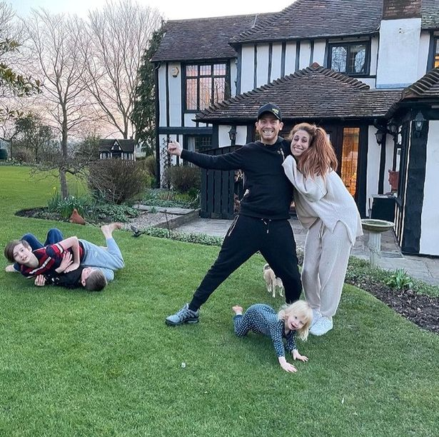 Stacey Solomon and Joe Swash outside their new home