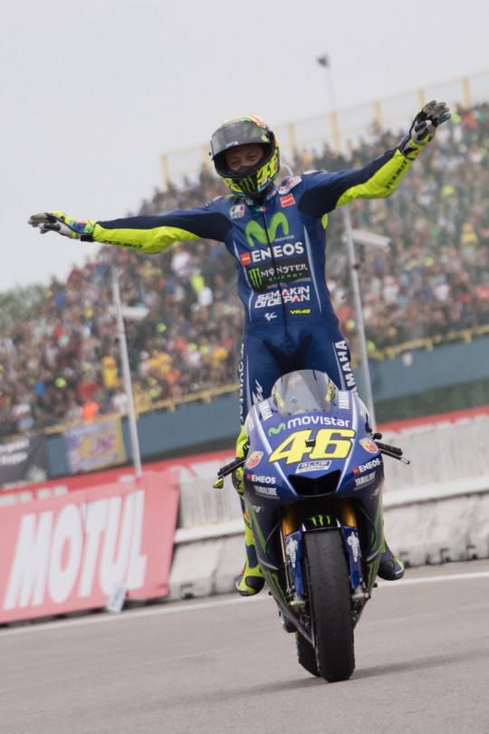 ASSEN, NETHERLANDS - JUNE 25: Valentino Rossi of Italy and Movistar Yamaha MotoGP celebrates the victory and arrives under the podium at the end of the MotoGP Race during the MotoGP Netherlands - Race on June 25, 2017 in Assen, Netherlands. (Photo by Mirco Lazzari gp/Getty Images)
