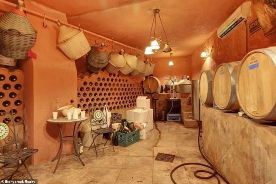 Lap of luxury:Their home features such features as a wine cellar whose style of architecture is reminiscent of the family's Italian roots
