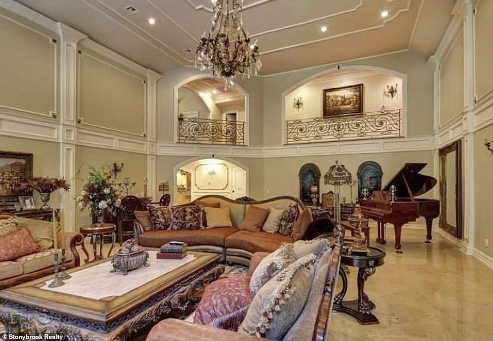 Living it up:A sumptuous grand living room includes a handsomely appointed fireplace and can be seen from the balconies of one of the upper levels