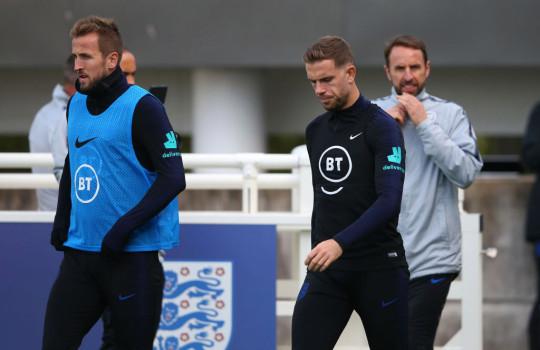 Harry Kane, Jordan Henderson and Gareth Southgate look on in England training