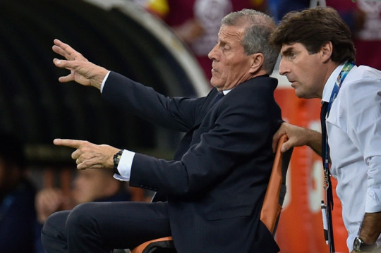 Oscar Tabarez and Mario Rebollo look on during Uruguay's clash with Ecuador