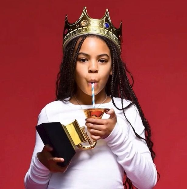Beyonce's daughter Blue Ivy sips juice out of first Grammy while wearing crown