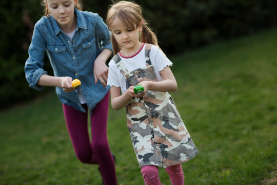girls competing in an egg and spoon race