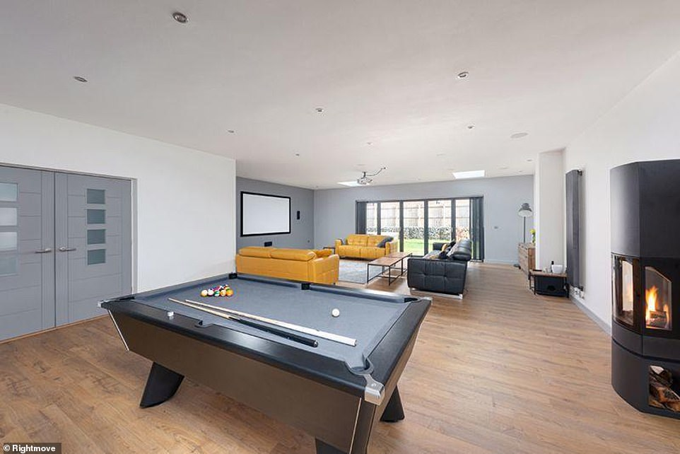 Incredible:The house, worth £1,100,000, overlooks the surrounding countryside and boasts a cinema room and a huge garden - perfect for fun-filled nights in with guests