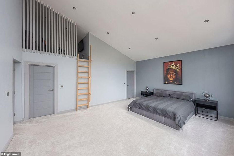 Simplistic: The third bedroom mirrored the simplicity of the first sleeping area, while the current homeowner seems to be a fan of the lateNotorious B.I.G.