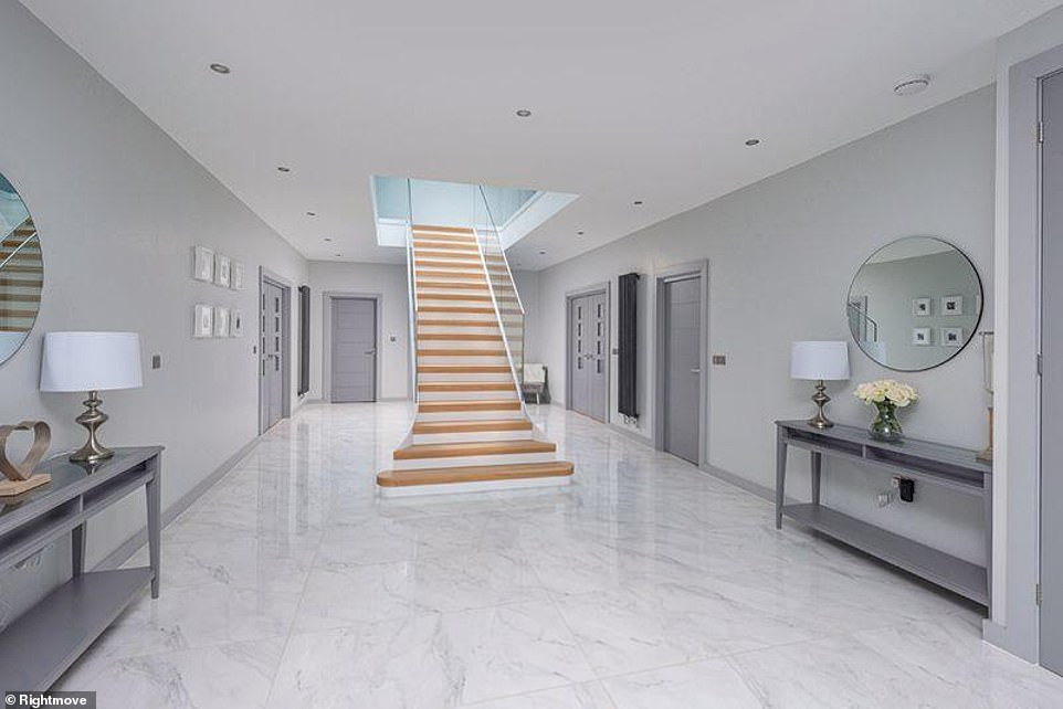 Sleek: The entrance immediately welcomes visitors to the wooden staircase, while setting the modern tone of the building with its white and grey colour theme