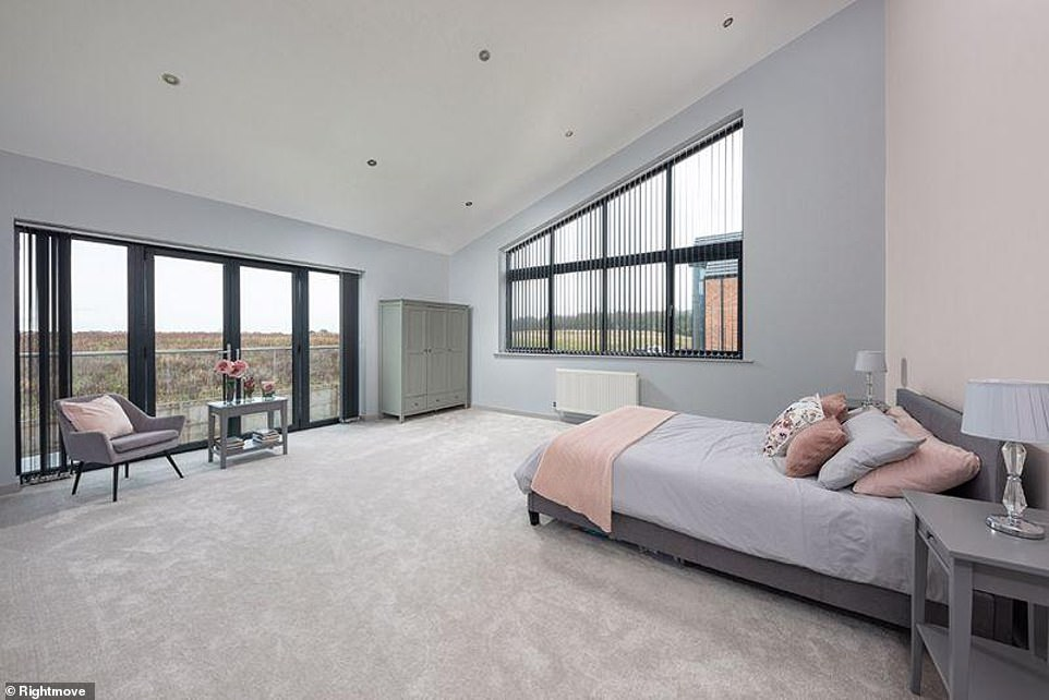 All about the views: Another bedroom suite has dual aspect windows with a Juliet balcony