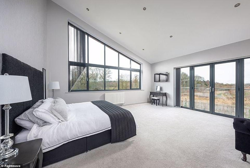 Fit for a king of queen: The master bedroom takes things up a notch with feature windows opening to another balcony, as well as a walk-in wardrobe