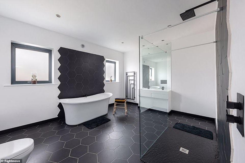 Stand-out elements: Drawing potential buyers in, a rainfall shower head and hexagon-shaped tiles is placed in one of the main bathrooms