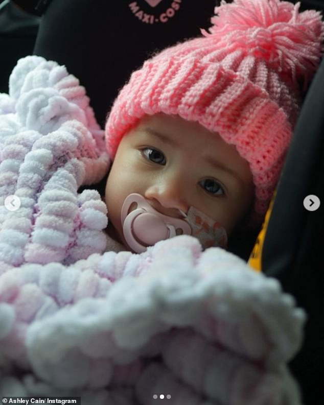Sweet:Sharing a picture of Azaylia in her car seat all tucked-up in a pink blanket, Ashley wrote: 'The added pressure of whats riding on this just takes the nerves to a whole new level'