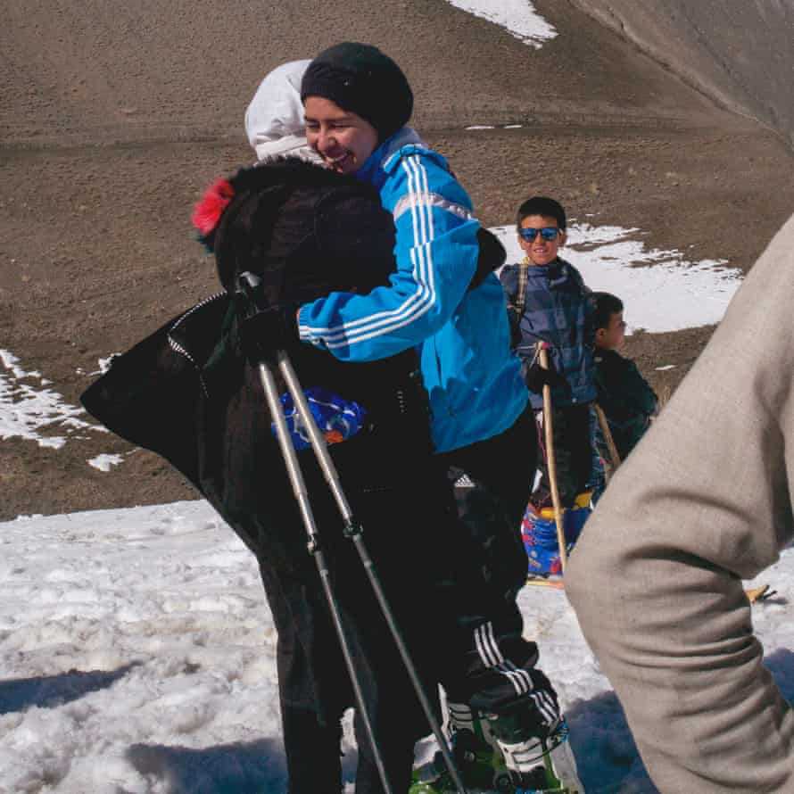 Nazira hugs a friend in celebration after realising she has won the Afghan Ski Challenge ladies race