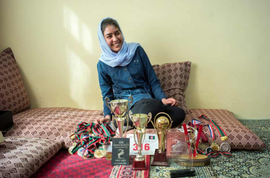 Nazira Khairzad aged 18, poses for a picture at her home with her trophies and medals from other sporting events including skiing, football and marathons.