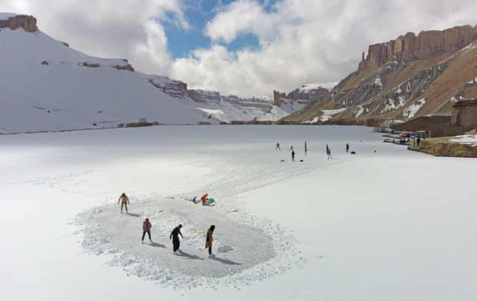Members of the Bamyan Ski Club enjoy a day of ice-skating and football on a frozen lake in Band-e-Amir.