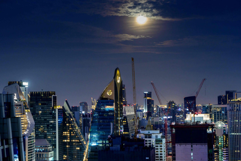 The full Worm Moon is seen over Bangkok's skyline on March 28, 2021. (Photo by Mladen ANTONOV / AFP) (Photo by MLADEN ANTONOV/AFP via Getty Images)