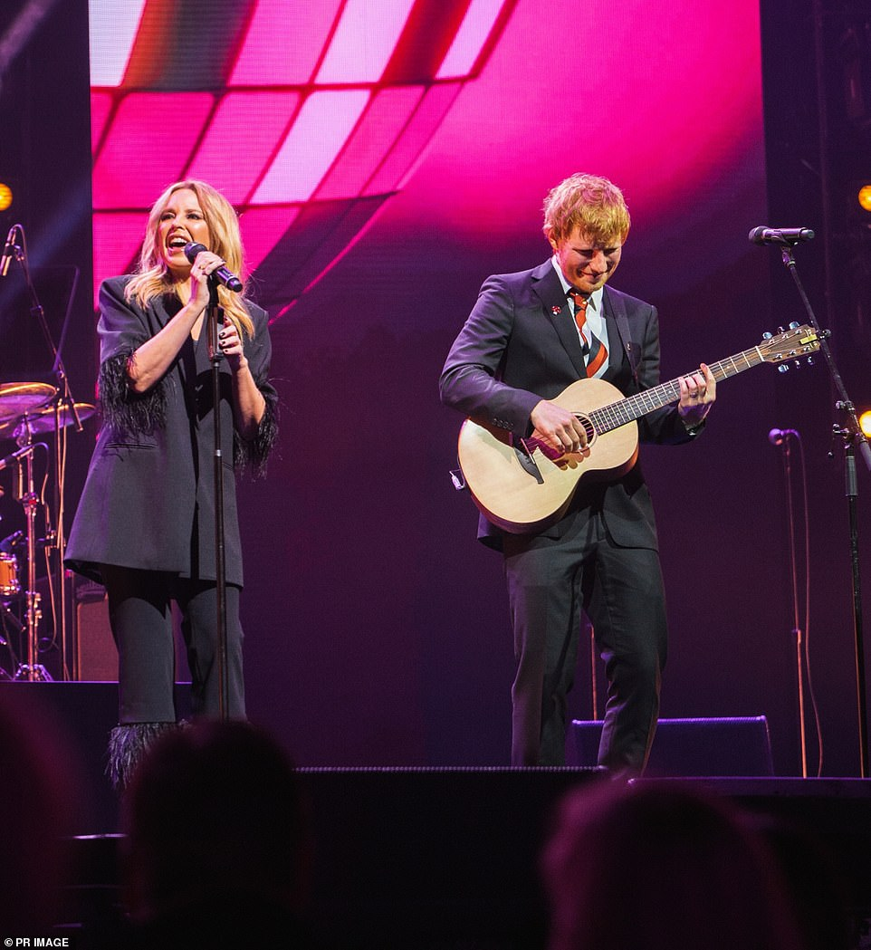 Making Michael proud: He also shared the stage with Kylie Minogue (left) - whose music career was launched by Michael - to do a duet of her songs All The Lovers and The Loco-motion