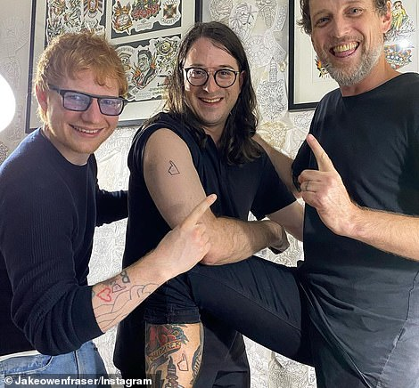 Moving:The singer was joined Gudinski's son Matt (centre) as they visited Grey Street Tattoo in Melbourne's St Kilda on Thursday, and had matching tributes inscribed on their arms