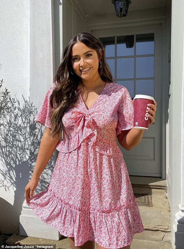 Confident: Another outfit included a cute pink smock mini-dress with white flower detail, layered with frills