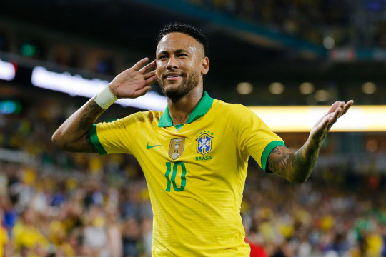 Neymar Jr. #10 of Brazil reacts after assisting Casemiro #5 (not pictured) on a goal against Colombia during the first half of the friendly at Hard Rock Stadium on September 06, 2019 in Miami, Florida.
