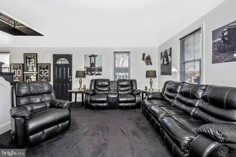 black living room with sports jerseys