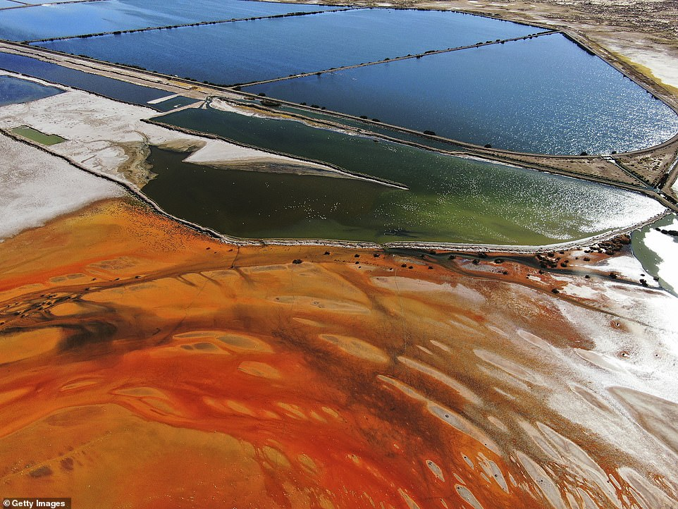 An aerial view of sewage water pools next to the contaminated area of Lake Uru Uru shows how much the colour of the resevoir's water has changed because of pollution
