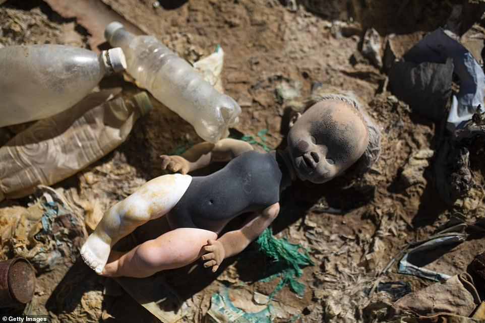 A discoloured doll, likely thrown into the Tagarette river outside Oruro, has washed up on the now mostly waterless basin of Lake Uru Uru