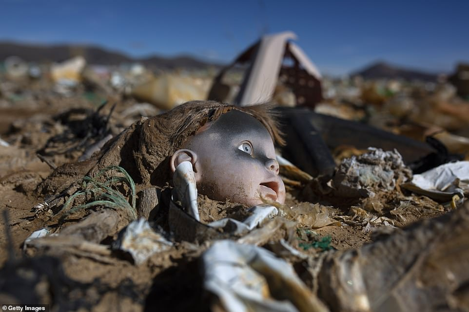 Lake Uru Uru now plays host to piles of unwanted man-made waste, including discarded dolls which lie among toxic waste leached into the waterway by mining companies