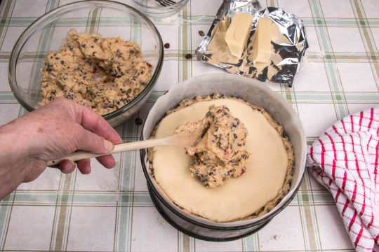 Making Simnel cake, adding the top layer of cake mixture